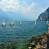 """Optimist dinghies heading out from Sailing Centre """"Fraglia Vela Riva"""" for racing at the 51st. Optimist World Championship 2013."""