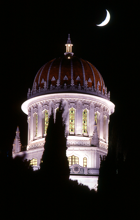 The Shrine of the Báb at night with crescent moon, Haifa, Israel.