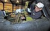 """Dixie Wing's Lonnie Webster shows an original .50 Calibre Machine Gun mounted in the rear cockpit of the """"Dauntless Dive Bomber"""". This """"Dauntless"""" is the last surviving Dauntless in the world to hold a flight certification.<br /> <br /> This SBD is a movie star! If you want to see the """"Dauntless"""" SBD-5 in action, watch the film """"Midway,"""" or rent the blockbuster mini-series """"The Winds of War"""" and its sequel, """"War and Remembrance."""""""