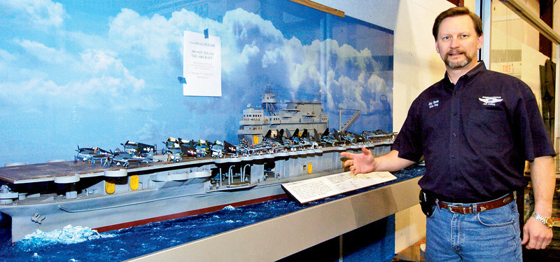 Dixie Wing's Jay Bess shows us a realistic scale model of an aircraft carrier complete with fighter planes and crew members on display