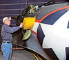 "Dixie Wing's Lonnie Webster shows the inflateable liferaft in the side of the ""Dauntless""<br /> <br /> The SBD is a movie star! If you want to see our own ""Dauntless"" SBD-5 in action, watch the film ""Midway,"" or rent the blockbuster mini-series ""The Winds of War"" and its sequel, ""War and Remembrance."""
