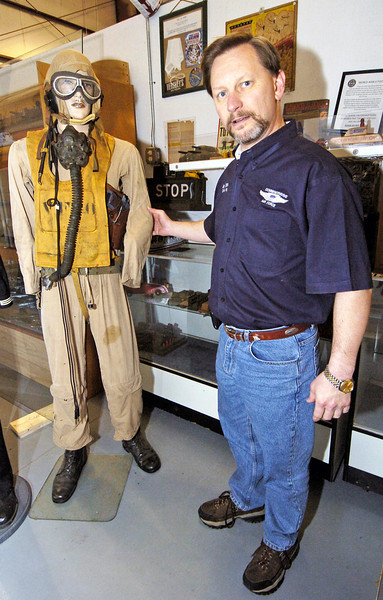 Dixie Wing's Jay Bess shows us an original WWII Flight Suit on display