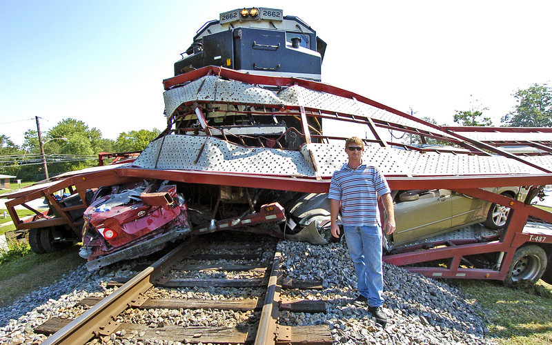"""The Train Engineer that was driving the train when it hit the truck. He said there was nothing he could do but tighten his seat belt and brace for impact.<br /> <br />  I asked him if he was scared and he said """"Nope, not at all, I knew it would be loud but I also knew I would win"""".."""