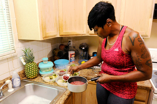 Don Knight   The Herald Bulletin<br /> Shyrley Jones prepares her lunches for the work week, a mix of Quinoa and vegetables. Changes in diet and regular exercise have Jones in the best shape of her life.