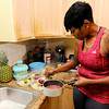 Don Knight | The Herald Bulletin<br /> Shyrley Jones prepares her lunches for the work week, a mix of Quinoa and vegetables. Changes in diet and regular exercise have Jones in the best shape of her life.