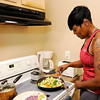Don Knight   The Herald Bulletin<br /> Shyrley Jones cooks vegetables as she prepares her lunches for the work week.