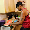 Don Knight | The Herald Bulletin<br /> Shyrley Jones cuts up a watermelon on the weekend to have as a healthy snack during the work week.