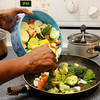 Don Knight | The Herald Bulletin<br /> Shyrley Jones cooks vegetables as she  prepares her lunches for the work week.