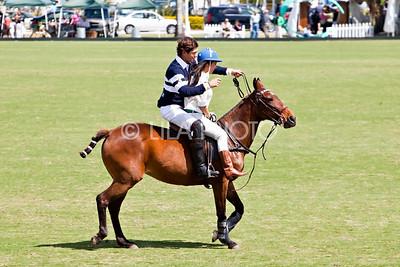 Kourtney Kardashian getting a polo lesson from Nic Roldan