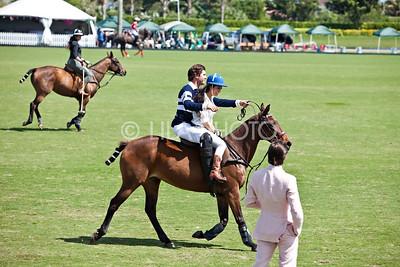 Kourtney Kardashian getting a polo lesson from Nic Roldan, Khloe Kardashian riding in the background, Scott Disick looking on