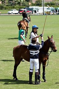 Kourtney Kardashian getting a polo lesson from Nic Roldan, Khloe Kardashian riding in the background with Kris Kampsen looking on