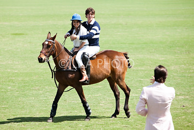 Kourtney Kardashian getting a polo lesson from Nic Roldan with Scott Disick looking on