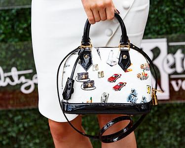 Stephanie Lynch wearing a Louis Vuitton purse
