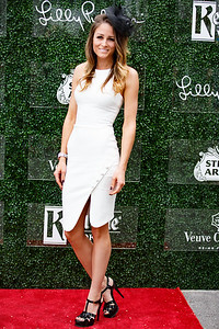 Stephanie Lynch, wearing Yves Saint Laurent shoes and an Elizabeth & James dress