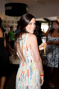 (fashion) Shannon Ramirez (wearing Armani) shows off her open back  dress while toasting champagne