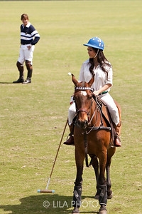 Kourtney Kardashian getting a polo lesson at IPC with Luis Escobar looking on