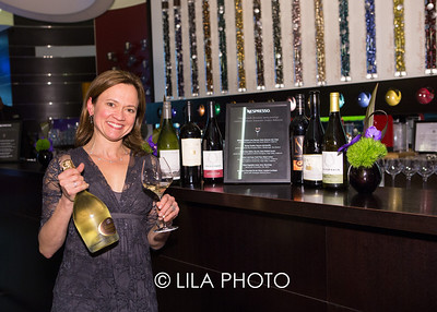 Master Sommelier Andrea Robinson(l), with here select pairings for Michelle Bernstien's menu at the culinary inspired after-party at Nespresso's flagship boutique during South Beach Wine and Food Festival's kickoff night.