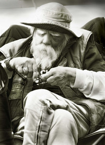 Old fisherman on the San Clemente Pier, California