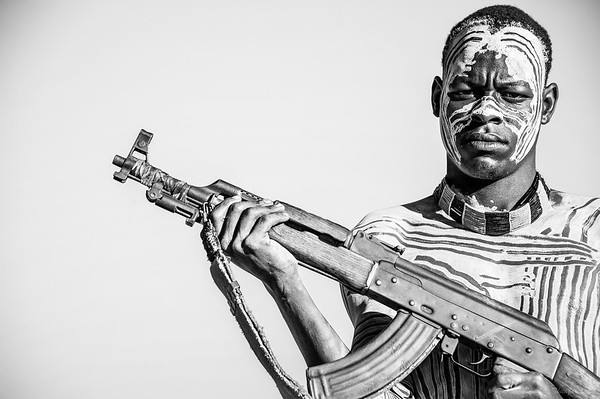 Karo warrior with the ubiquitous AK47