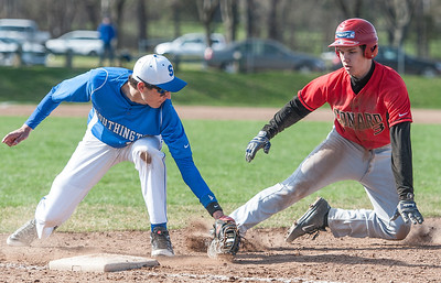 Out! Southington vs. Conard high school baseball.