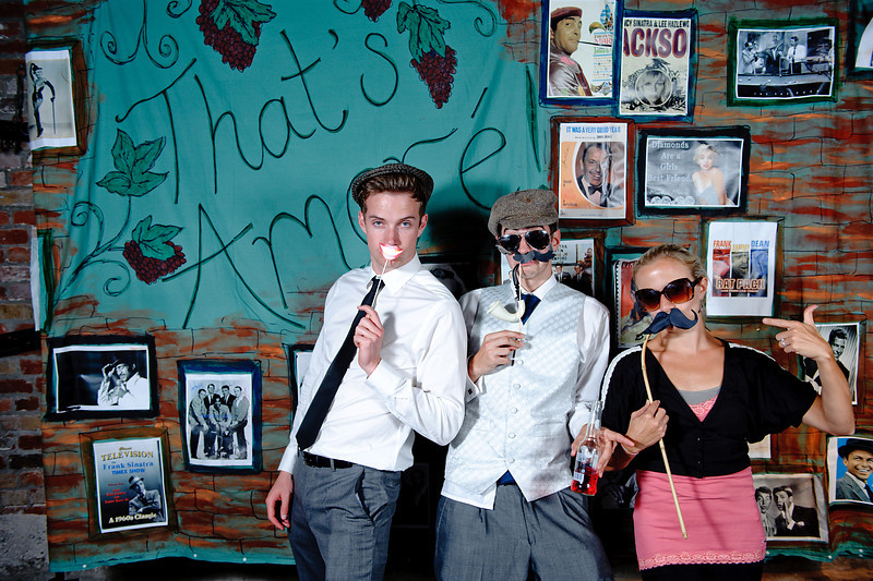 Daryl & Vicki's Rat Pack Backdrop<br /> Rochester, England<br /> <br /> A painted brick wall backdrop showcases images of Rat Pack stars besides a 'That's Amore' mural.<br /> Mustaches, bow ties, cigars and anything else 60's entertain the guests.<br /> <br /> Custom, hand painted photo booths<br /> Denver, Colorado & Destination Wedd