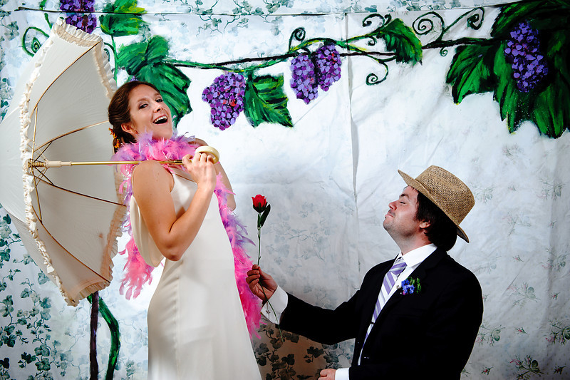 Christina & Jason<br /> Colorado Vineyard Photo Booth<br /> Denver, Colorado<br /> <br /> This photo booth took place at Chatfield Botanical Gardens in Denver, Colorado.  The theme the bride & groom chose was anything wine featuring grape stomping, wine drinking & just an overall great time!  Our photo booth back drops are all custom made to suit the style of your wedding, party or event.  Contact us for more details at yaggiphotography@gmail.com