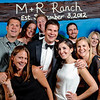 Miranda & Robert's Colorado Ranch<br /> Denver, Colorado<br /> <br /> Group photo underneath the ranch gateway.<br /> <br /> Custom, hand painted photo booths<br /> Denver, Colorado & Destination Wedd