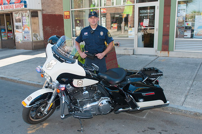Sept. 16, 2015- New Britain Police Officer Wojtek Sztachelski stands next to a brand new 2015 Harley Davison motorcycle on W. Main St. It's 1 of 6 new Harley's that the department has. (Ray Shaw Special to the Herald)