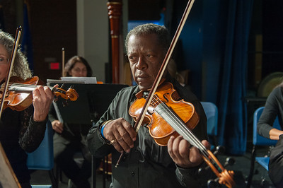 Jan. 31, 2016- Charles Ives comes to Bristol: Nutmeg Symphony orchestra collaborating with Bristol Eastern Madrigal Singers for Concert. On violin, Jerry Guerrero Jr. of Bloomfield.(Ray Shaw Special to The Press)