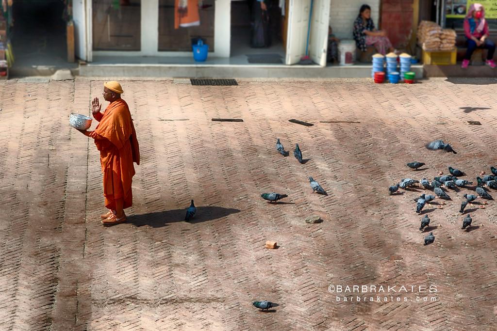 Buddhist Monk with Alms Bowl, Boudhanath Stupa, Kathmandu, Nepal