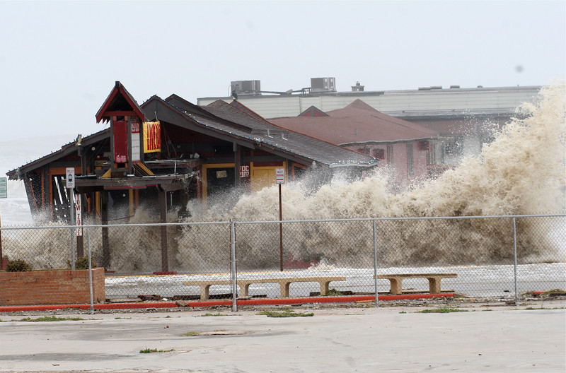 Giant waves, created in advance of Hurricane Ike in 2008, crash into shops and restaurants on piers off of Sea Wall  Blvd in Galveston Texas.  Ike's eye eventually came ashore over Galveston with category 3 winds killing over 100 and until Irene in 2011, was the costliest hurricane to make landfall in the United States.
