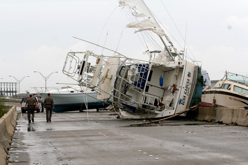 National Guard officers survey boats that are blocking access to Galveston Island on Interstate 45 after Hurricane Ike in 2008.