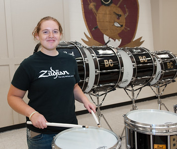 Senior drummer Harmony Gregory (17) playing a snare drum, one that was purchased from Cheney family donations. (Ray Shaw Special to the Herald)
