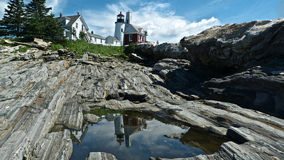 Pemaquid Point Light reflection in a tidal pool, sunny morning