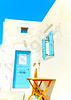 A beautiful blue colored door of a traditional old house in Chora the capital of Amorgos island in Greece colored wooden door of a traditional old house in Chora the capital of Amorgos island in Greece