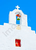 Beautiful belltower on a white church in Chora the capital of Amorgos island in Greece