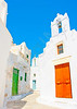 Beautiful stone made road with old traditional houses and a white church in Chora the capital of Amorgos island in Greece