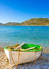 Old traditional beautiful green fishing boat by the sea in Amorgos island in Greece