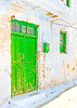 A beautiful green colored door of a traditional old house in Chora the capital of Amorgos island in Greece