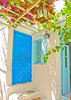 A beautiful traditional old house with pergola and blue colored doors and windows in Chora the capital of Amorgos island in Greece