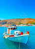 traditional fishing boat at the main port of the Pserimos pictorial island in Greece