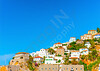 Beautiful old houses over the main port of Hydra island in Greece
