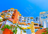 Beautiful complex of colored houses in Fira the capital of Santorini island in Greece