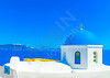 The blue colored dome of an old  traditional church in Oia the most beautiful village of Santorini island in Greece