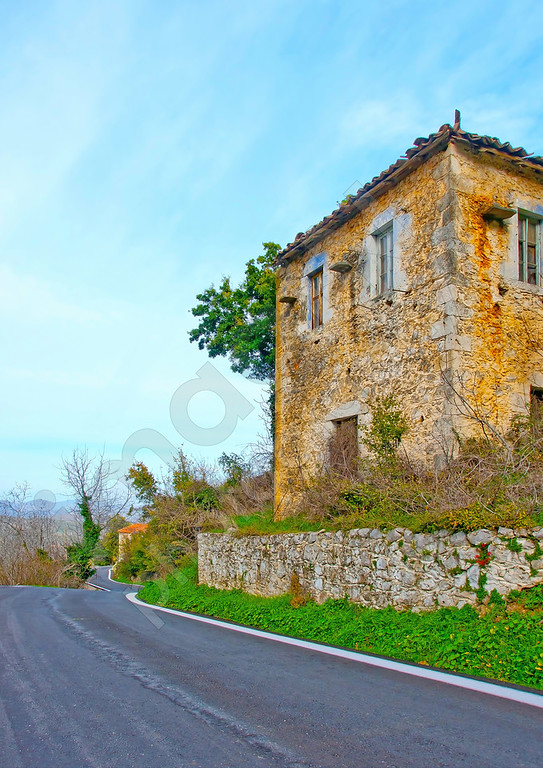 Old house in front of a road in a small village in Peloponnese Greece