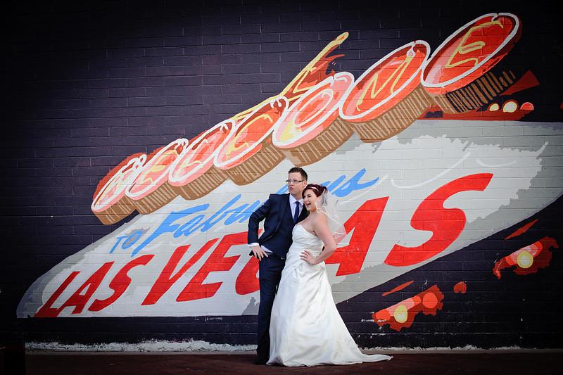 Bride & Groom posing in front of Welcome to Vegas mural<br /> Las Vegas, Nevada