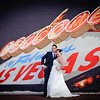 Bride & Groom posing in front of Welcome to Vegas mural<br /> Las Vegas, Nevada