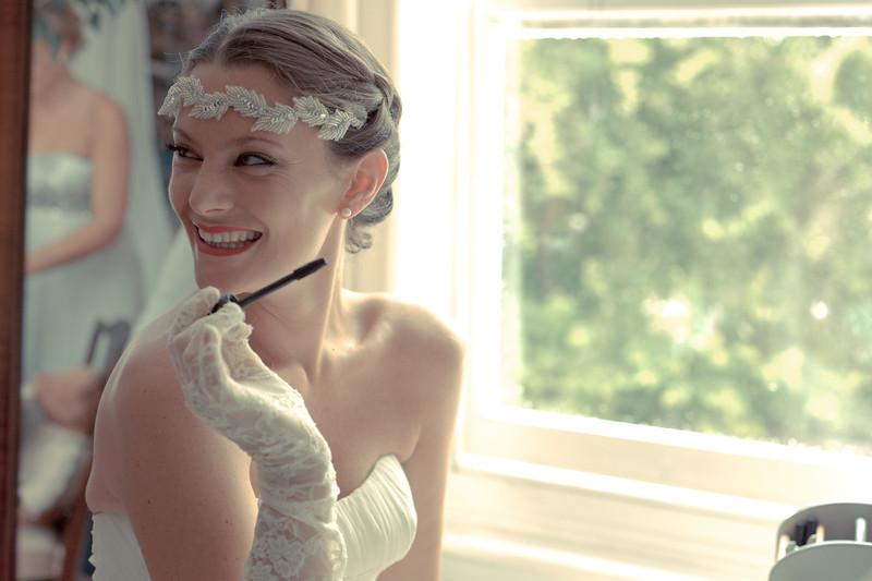 The beautiful bride, Marijke, putting her own make-up on pre-wedding