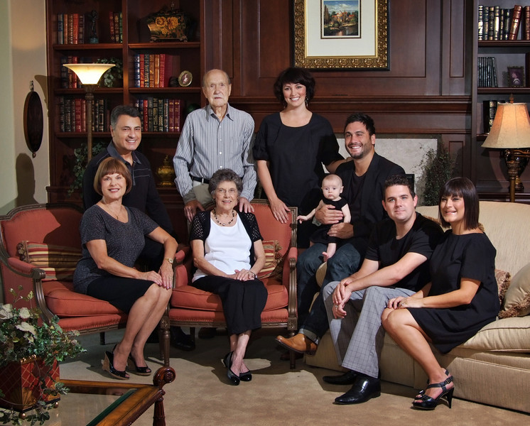 """Here is a classic example of clients who tried to coordinate but did not realize that while white and grey """"go with"""" black, the contrast is distracting in a portrait! Here you can see the difference where everyone is dressed in dark grey or black. The eyes focus on the subjects instead of zero-ing in on the white shirt! Changing white or light grey to black is definitely not an easy task, and although I did it to demonstrate this point for my gallery, I would not volunteer to do it for a client. It is extremely time consuming and difficult to make believable, therefore would require an additional art fee. The best answer is to have the client wear anything dark--even if it is purple or navy or green! It is easy to take an already dark color and make it black by desaturating. Making white into black is agony! :)"""