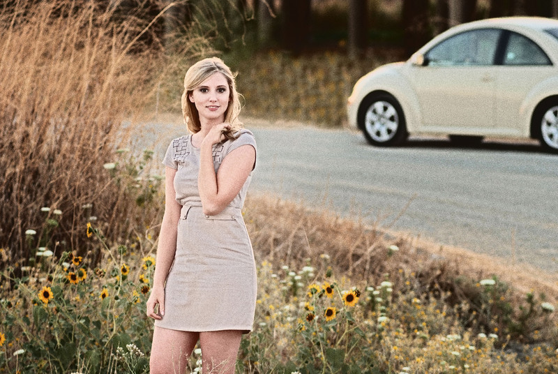 I moved Sarah over for better composition using CS5 refine edge and content aware fill to fill the space. It took some cloning too, but the content aware finished it off nice. Then I moved her over and moved the flowers over to where she was, since she covered up the best ones! <br /> Topped it off with NIK Software's Color Efex Pro 3.0 Old Photo filter #5 in Luminosity mode....sweet!